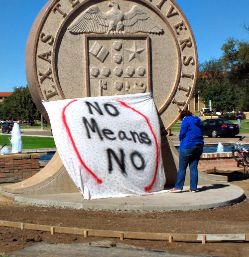 """In 2014, Texas Tech freshman Regan Elder helps drape a bed sheet with the message """"No means No"""" over the university's seal on the Lubbock campus. Students put up the bed sheets at three locations to protest what they say is a """"rape culture"""" on campus. Below, Shannon Zurcher is the director of collegiate outreach for the Fellowship of Catholic University Students (Focus)."""