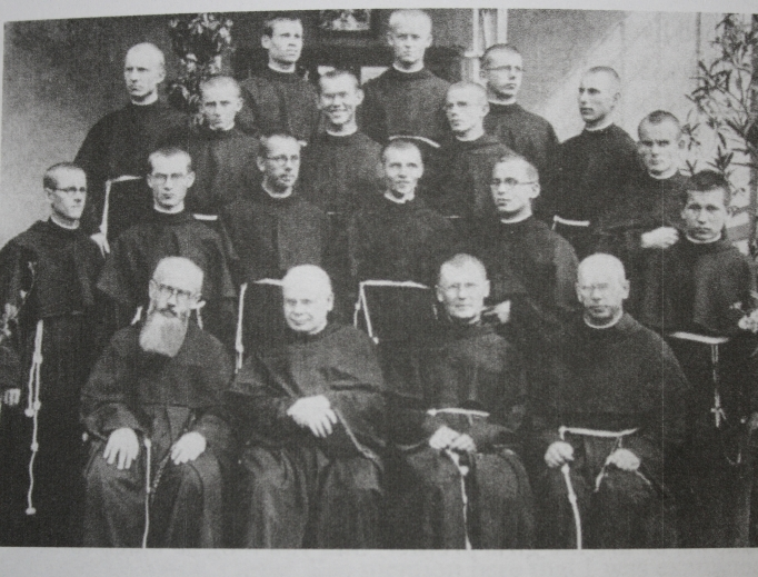 Above, Franciscan Father Lucjan Krolikowski can be seen in a 1939 photograph with other seminarians posing with St. Maximilian Kolbe — Father Lucjan is the one with the big smile. Below, Father Lucjan smiles for the Register from his Connecticut residence.