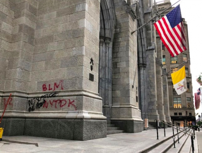 Graffiti on the exterior of St. Patrick's Cathedral in Manhattan.