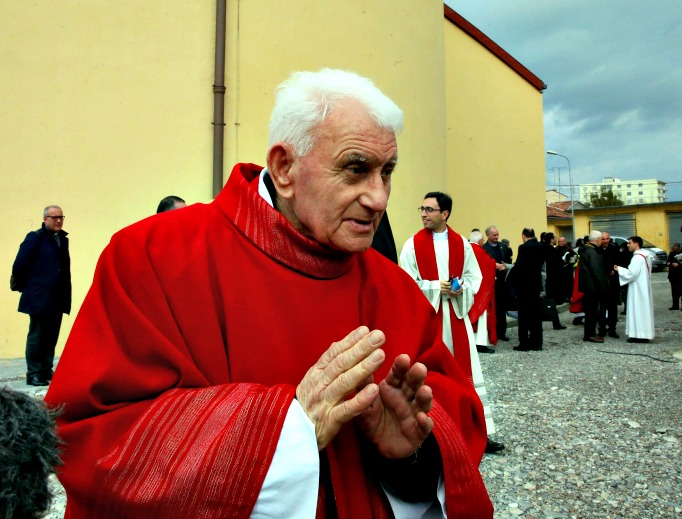 Cardinal-designate Ernest Troshani Simoni attends the beatification of 38 Catholic martyrs executed or tortured to death during the former communist regime, in Shkoder, Albania, Nov. 5. Below, Albania's first indigenous Catholic charismatic community, Temple of God, was founded in 1996 by Father Prelë Gjurashaj, a Franciscan priest of Albanian origin.