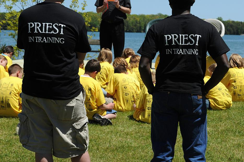 Seminarians Patrick La Pacz and Alvan Amadi listen as Father Tom Long addresses youths gathered at St. Joseph Retreat House in Bailey's Harbor, Wis., during a retreat focusing on Catholic vocations in 2009.