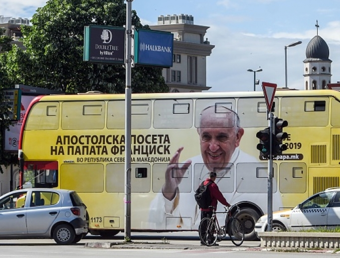 A bus featuring the portrait of Pope Francis drives in Skopje on May 6, ahead of the papal visit. Pope Francis three-day tour, in Bulgaria and in North Macedonia, includes a commemoration of Mother Teresa, the most famous native of the North Macedonia's capital of Skopje.
