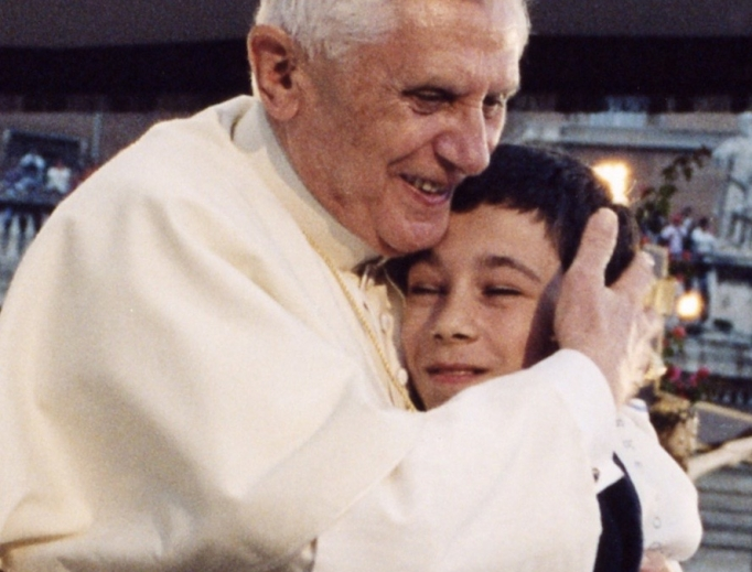 Pope Benedict XVI hugs a boy during his weekly General Audience.