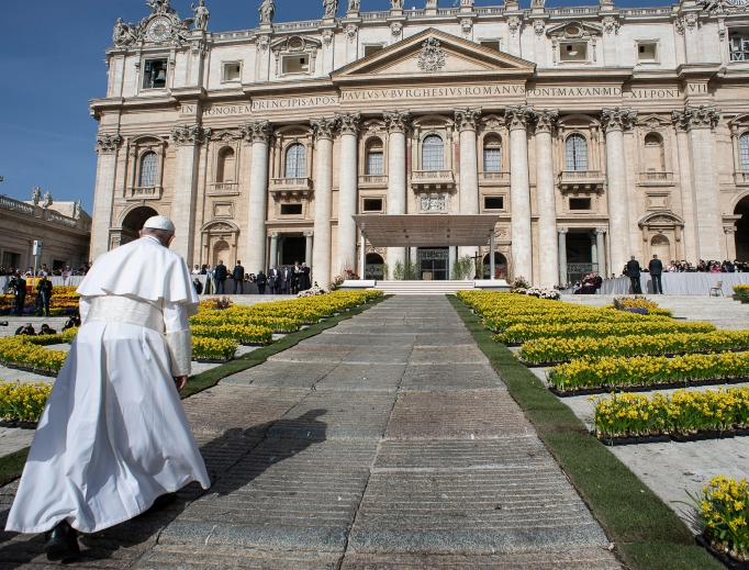 Pope Francis walks towards the St. Peter's Basilica in  St. Peter's Square during the Wednesday general audience on April 24.