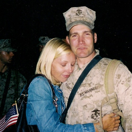 J.J. Hanson gets a hug from his wife, Kristen, after returning from a combat tour in Iraq. The former U.S. Marine is a brain-cancer survivor who is now battling the legalization of assisted suicide.