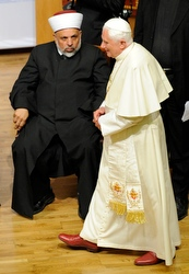 The Pope walks past Sheik Tayseer Rajab Tamimi at the interreligious dialogue meeting.