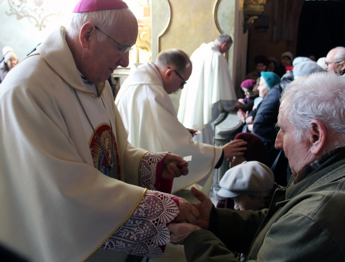 Bishop Ignacy Dec of Swidnica, Poland, anoints the sick of his diocese at a service last month.