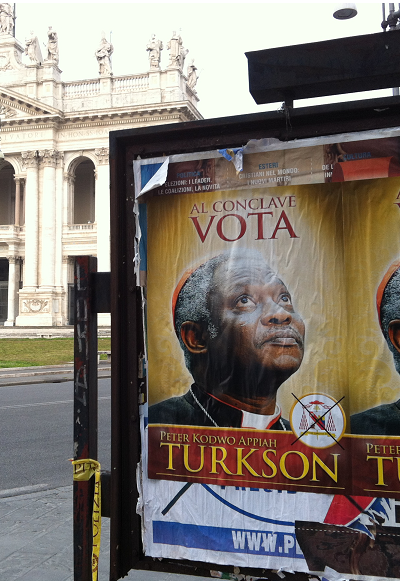Fly posters urging cardinal electors to vote for Cardinal Turkson have been appearing around Rome.