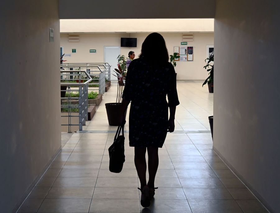 Casandra Guazo walks into Mexico City's Condesa Clinic, which specializes in patients with HIV and gender dysphoria, on July 18, 2019.