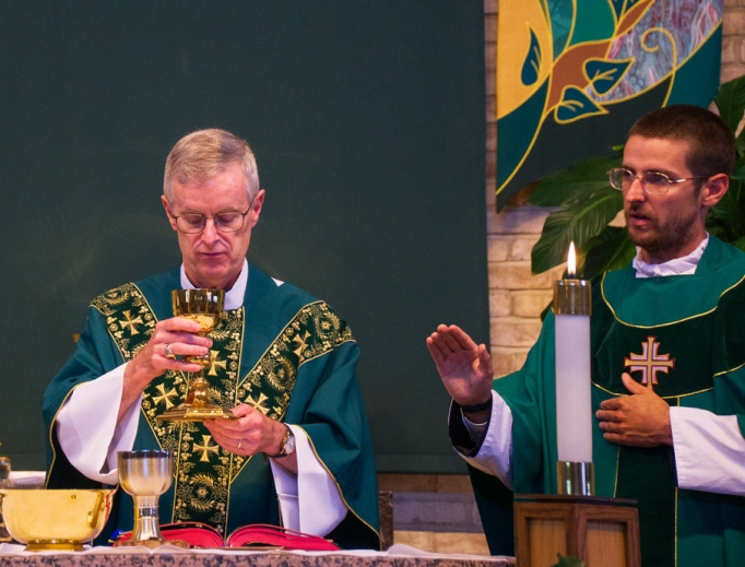 Fathers Peter (c) and Andrew Infanger (r) are biological father and son. Here, they concelebrate Father Peter's Mass of thanksgiving this past Father's Day at St. Matthew Church in Glendale Heights, Illinois.