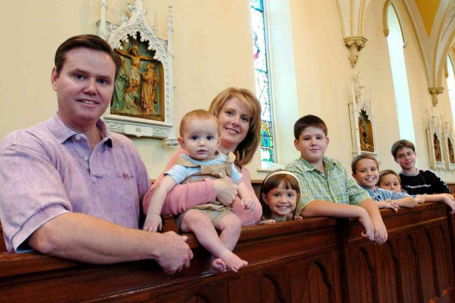 Deacon Dean Condon and his wife, Janet, and their six children at All Saints Church in Corning, N.Y. in December 2006.