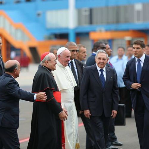 Pope Francis is greeted by Cuban President Raul Castro and other officials upon his arrival in Havana on Sept. 20.