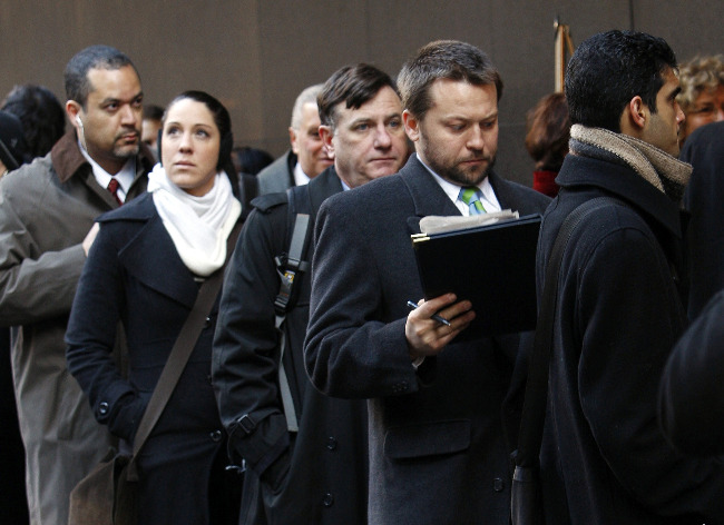 People wait in line for a job fair in New York's Times Square.
