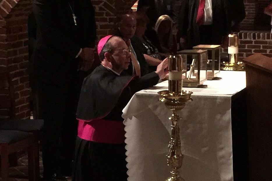 Archbishop William Lori venerates the relics of St. Thomas More and Josh Fisher at the basilica in Baltimore on June 21.