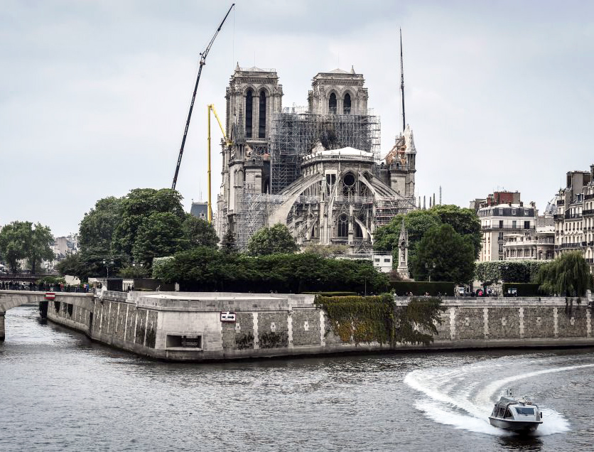 A police boat cruises along the River Seine past the Notre-Dame de Paris Cathedral on May 20.