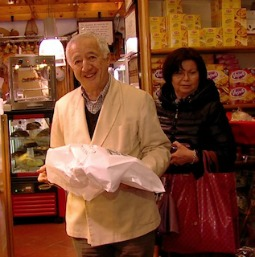 Angelo Colapicchinoi presents one of his Colomba cakes at his bakery near the Vatican.