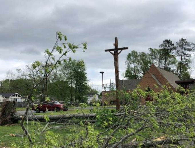 A crucifix outside a Tennessee church after storms over Easter, 2020.