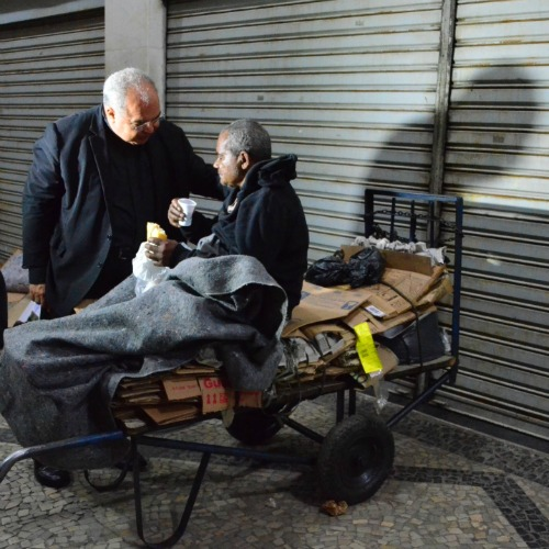 Cardinal Tempesta meets with a homeless man on the streets of Rio.
