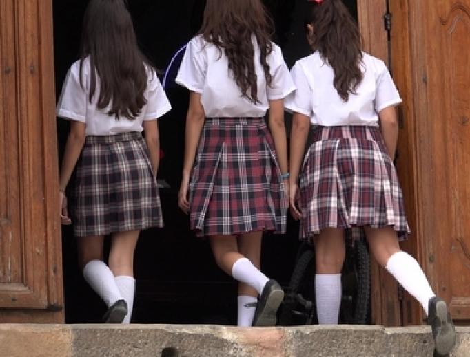 Catholic school girls enter their school's chapel.