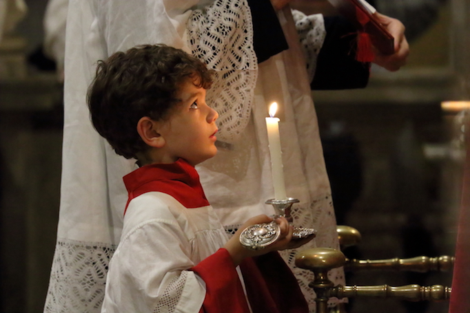 An altar boy at Solemn Vespers on the Feast of the Exultation of the Holy Cross, St Mark's basilica, on the occasion of the 10th anniversary of Summorum Pontificum, Rome, Sept. 15, 2017. Photos from top to bottom: Solemn High Mass in St. Peter's basilica, Solemn High Mass at the basilica of Santa Maria Sopra Minerva, priests process through Rome, Archbishop Guido Pozzo, priests process towards St. Peter's basilica, lay faithful and clergy process through Rome, Msgr. Gilles Wach celebrates Mass in Santa Maria Sopra Minivera, Father Claude Barth at Solemn Vespers, Martin Mosebach, Archbishop Pozzo at the beginning of Mass in St. Peter's, Cardinal Robert Sarah, Cardinal Gerhard Müller, Dominican nuns process over the Bridge of Angels, Solemn High Mass in Santa Maria Sopra Minerva.