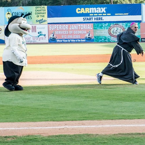 Bishop Gregory Hartmayer of Savannah, Ga., throws out the first pitch at Grayson Stadium on June 4.