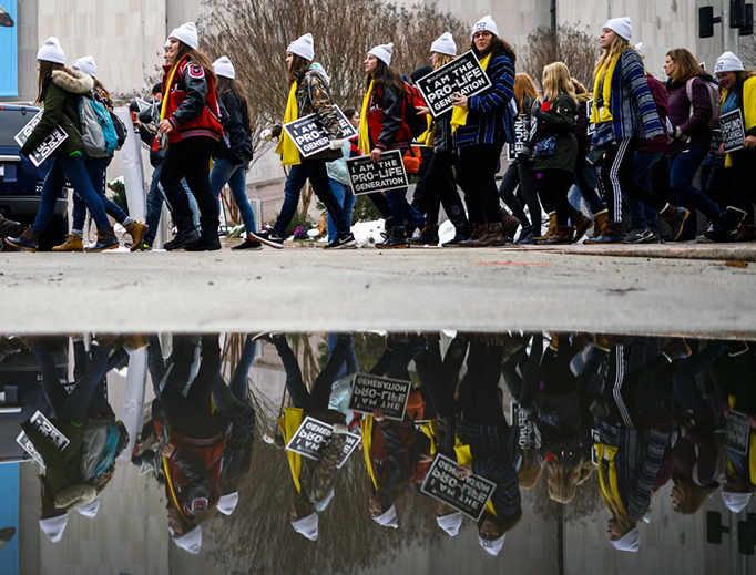 """Marchers carry signs during the annual """"March for Life"""" in Washington, D.C., Jan. 18, 2019."""