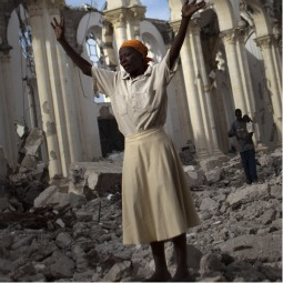 A woman prays amid the rubble of the damaged main cathedral in downtown Port-au-Prince, Jan. 9. Haiti is marking the first anniversary of the earthquake that killed around 250,000 people and wrecked much of the capital Port-au-Prince on Jan 12, 2010.