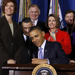 President Barack Obama signs the Don't Ask Don't Tell Repeal Act of 2010 into law at the U.S. Department of Interior in Washington Dec. 22.