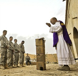 U.S. Army chaplain Father Carl Subler celebrates Mass for soldiers in Badula Qulp, Afghanistan, on Feb. 21, 2010.
