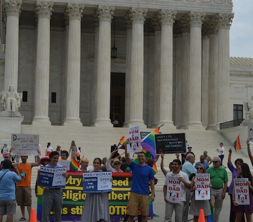 Supporters of traditional marriage and same-sex 'marriage' activists face off in front of the Supreme Court during the March for Marriage in Washington on June 19, 2014.