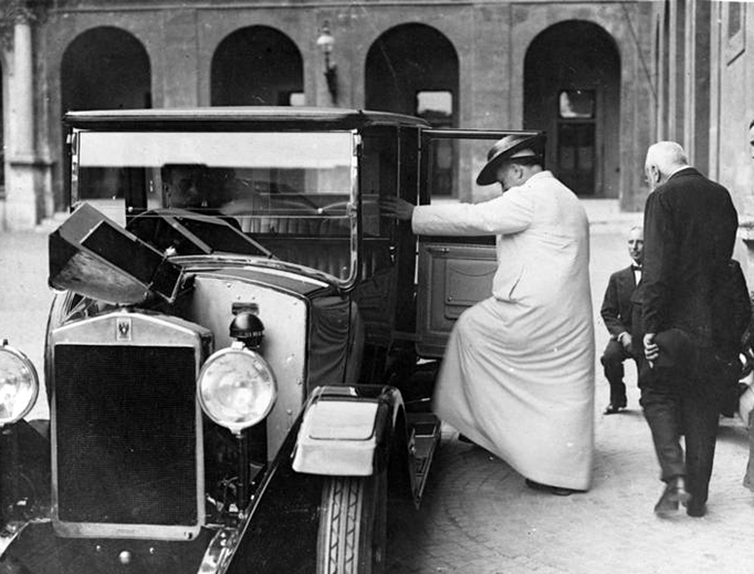 Pope Pius XI steps into a Bianchi Tipo 20 automobile in May 1931.