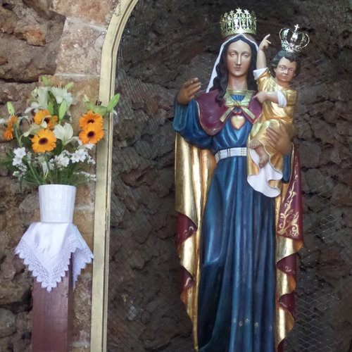 OUR LADY'S TEARS. The carved-wood statue is perhaps 150-200 years old and was made in Italy.