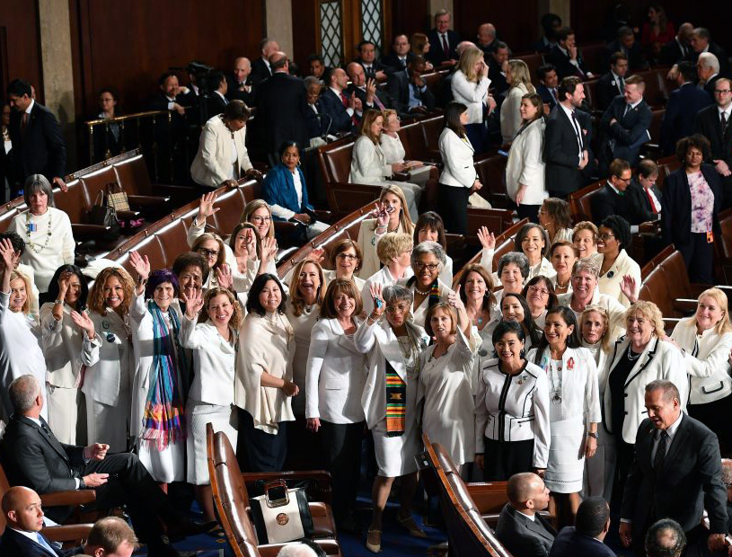 In a protest organized by the Democratic Women's Caucus, female members of Congress dress in white to show support for 'reproductive rights' and other causes before President Donald Trump's State of the Union address Feb. 4.