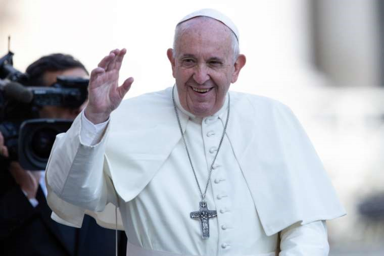 Pope Francis greets pilgrims in St. Peter's Square Nov. 6.
