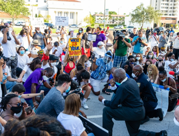 Protesters kneel in prayer in Coral Gables, Florida on May 30, 2020.