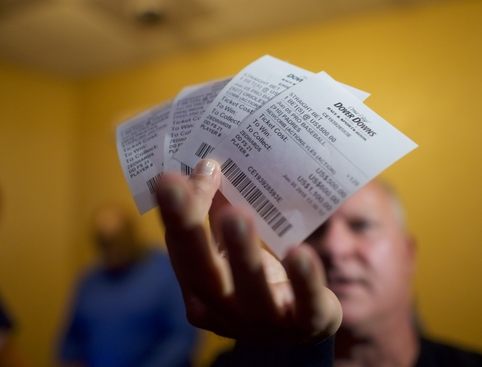 Sports adviser Stuart Feiner, who was portrayed by actor Al Pacino in the film Two for the Money, displays his betting tickets on Major League Baseball at Dover Downs Casino June 5 in Dover, Delaware. Delaware is the first state to launch legal sports betting since the Supreme Court decision.