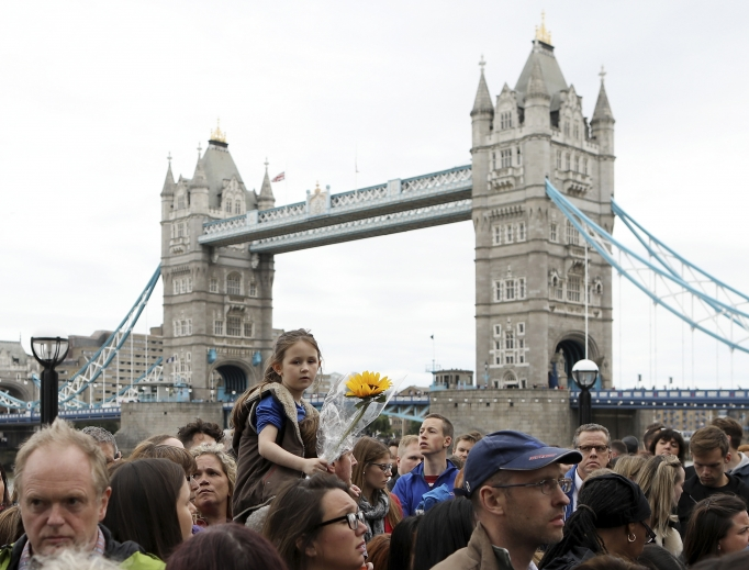 Members of the public take part in a vigil for the victims of the June 3 London Bridge terror attacks in Potters Fields Park on June 5 in London.