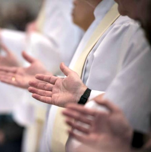 Priests celebrate Mass at the Cathedral of the Immaculate Conception in Denver on Jan. 17.