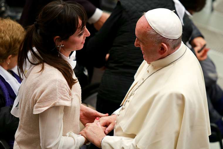 Pope Francis meets with a woman at the general audience in Paul VI Hall Jan. 13, 2016.