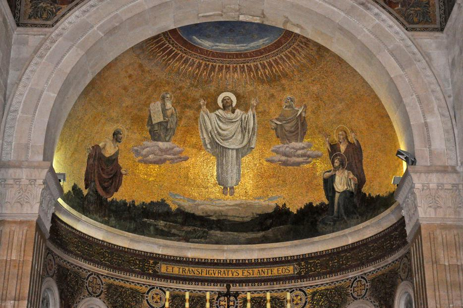 "The Transfiguration of the Lord (Umberto Noni, ca. 1924, mosaic, Church of the Transfiguration, Mount Tabor). The caption is Latin for ""And he was transfigured before them."" The Church of the Transfiguration on Mount Tabor (the mountain of the Transfiguration) was designed by the Franciscan monk and architect Antonio Barluzzi, nicknamed ""The Architect of the Holy Land."""