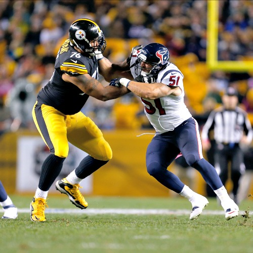 Houston Texans linebacker John Simon (51) runs in pursuit as Pittsburgh Steelers offensive tackle Mike Adams (76) blocks during a Week 7 NFL football game in Pittsburgh on Oct. 20.