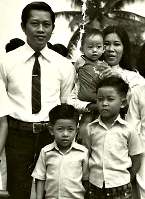 Peter and Mary Nguyen stand with their then three sons in Saigon, Vietnam, in 1974. Below, Peter and Mary mark 50 years of marriage earlier this year with Kansas City, Kan., Archbishop Joseph Naumann.