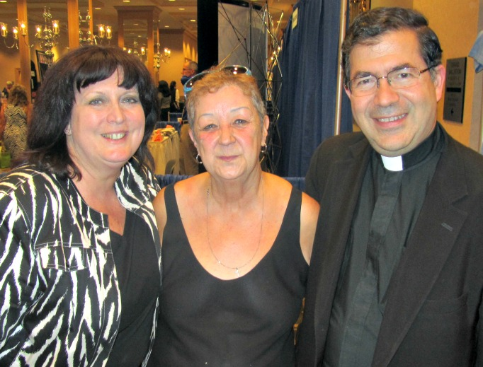 Norma McCorvey, flanked by Janet Morana and Father Frank Pavone of Priests for Life.