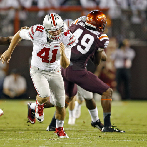 Ohio State's Bryce Haynes (41) heads downfield after a punt in a game against Virginia Tech.