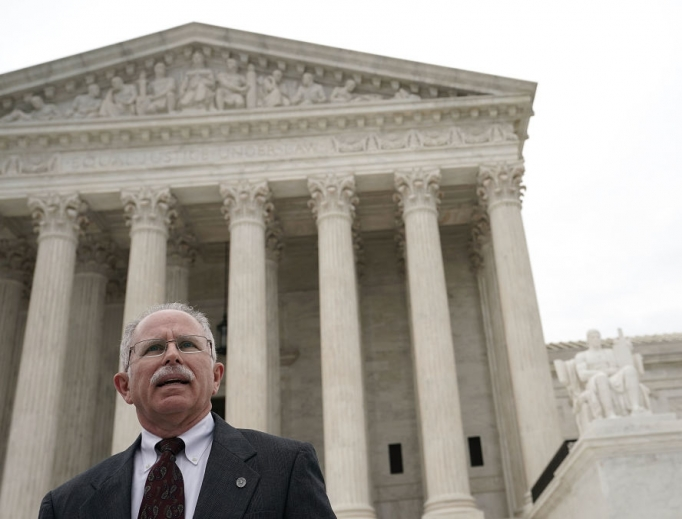 Plaintiff Mark Janus passes in front of the U.S. Supreme Court after a hearing Feb. 26 in Washington, D.C. The court heard the case, Janus v. AFSCME, to determine whether states violate their employees' First Amendment rights by requiring them to join public-sector unions.