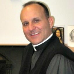 Father Paul Check, executive director of Courage International