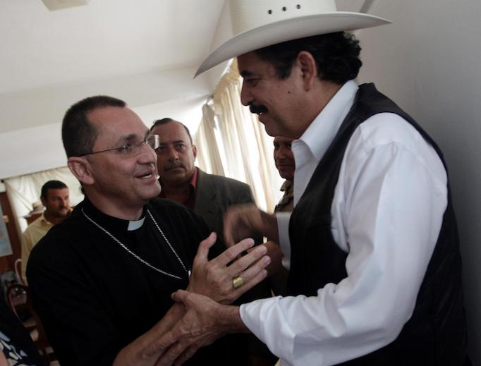 Auxiliary Bishop Juan José Pineda of Tegucigalpa shakes hands with Honduras' ousted President Manuel Zelaya (r) inside the Brazilian embassy in Tegucigalpa Sept. 24, 2009.