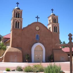 The plaster facade of San Miguel Parish in Socorro, N.M., has been opened in small sections to allow the 400-year-old adobe interior to dry, to prevent the wall from crumbling.