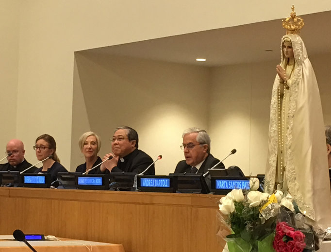 Above, panel discussion at the United Nations Pilgrim Virgin Statue event: Father Roger Landry (far left), of Holy See's Permanent Observer Mission at the U.N.; Johnnette Benkovic of EWTN; and Archbishop Bernardito Auza, the apostolic nuncio leading the Holy See's Permanent Observer Mission to the United Nations. Below, the crowd gathered at St. Patrick's Cathedral and the Missionaries of Charity venerating the statue