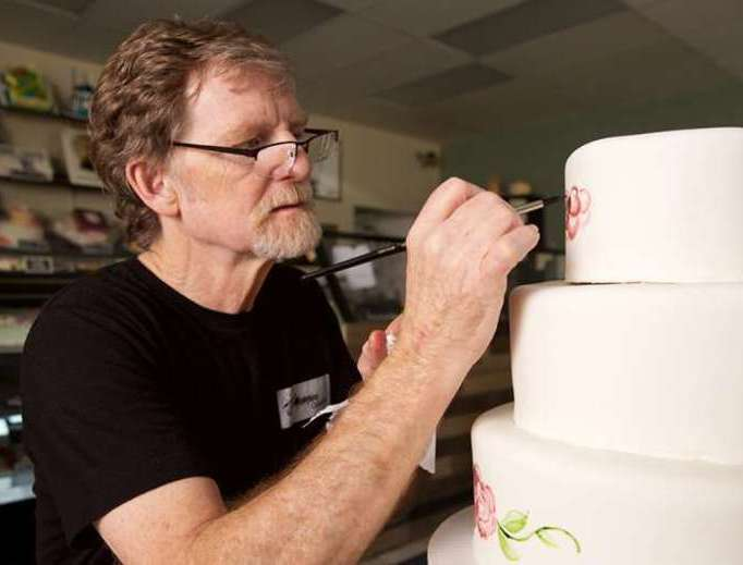 Christian baker Jack Phillips, owner of Masterpiece Cakeshop in Lakewood, Colorado, decorates a cake.
